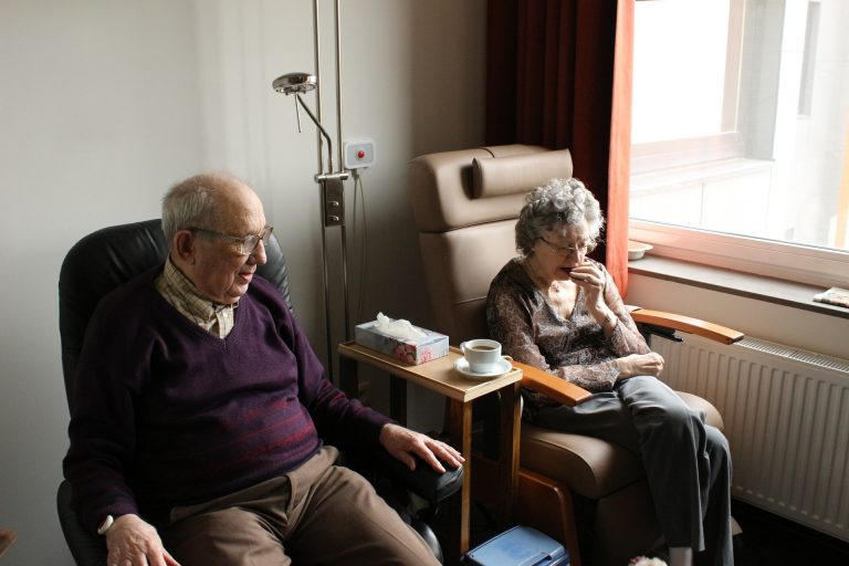 older couple sitting in hospital room