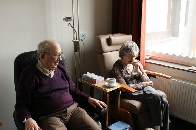 older couple sitting in hospital room