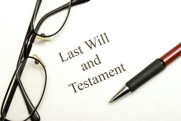 A gavel on top of Last Will and Testament papers